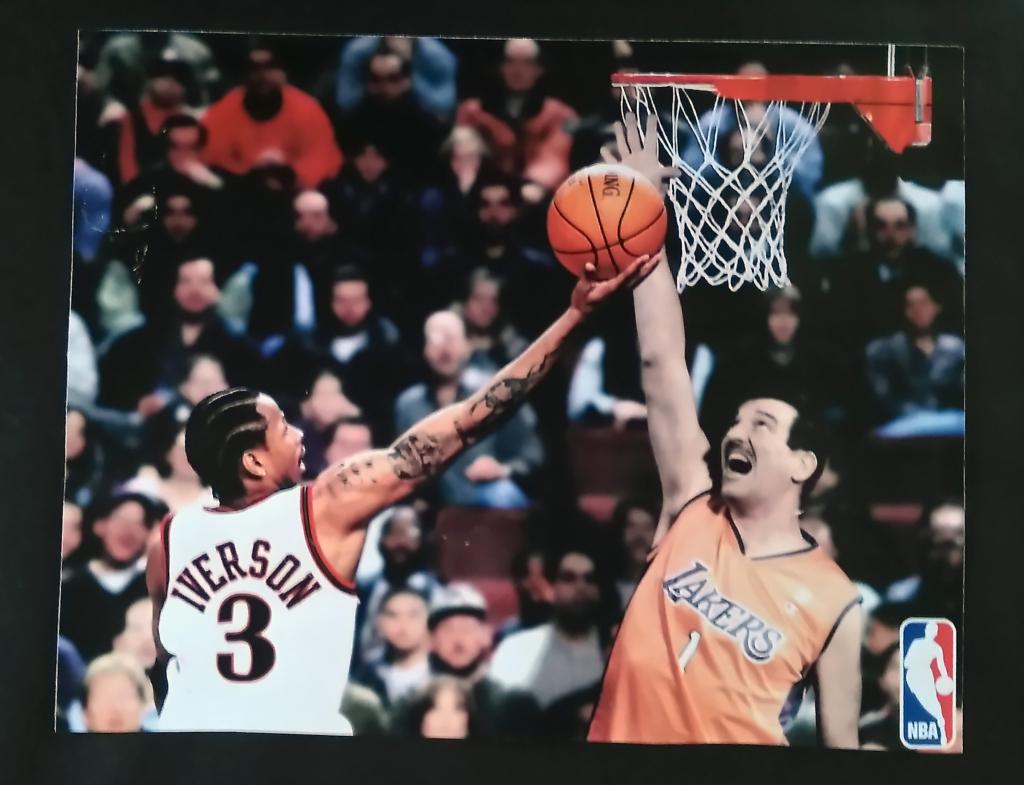 Bill Greguska blocking a shot of Allan Iverson