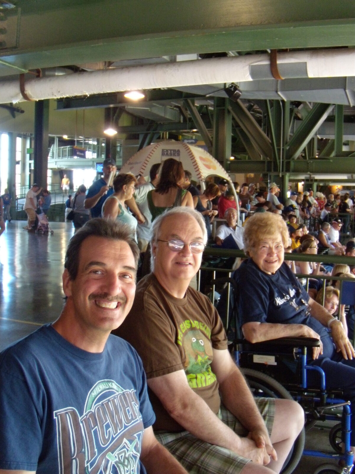 Cousin Joe and mom and me enjoying one of her favorite things, a Brewers game!