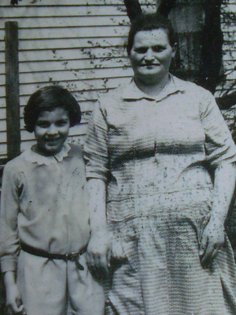 My mom as a little girl with my Nana! my Nana's death was before I was born.